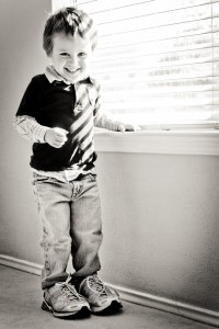 boy at window blinds